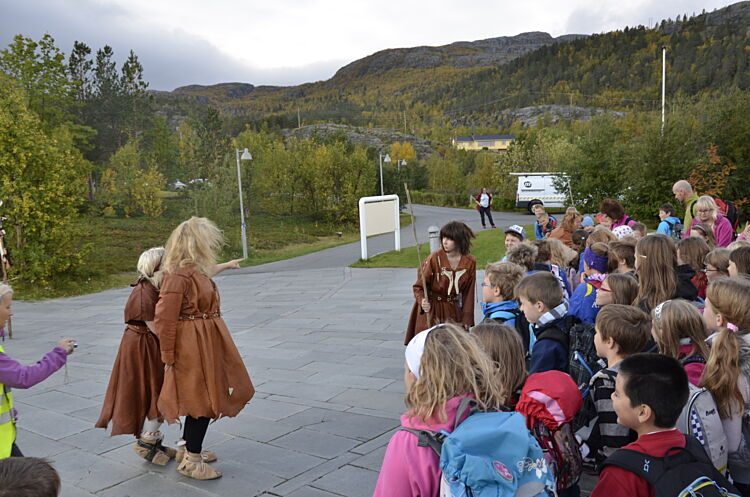 Children participating in the stone age educational program